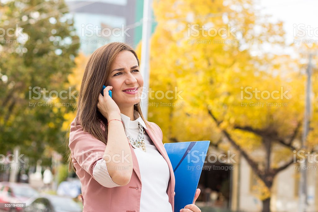 Happy pregnant woman talking on the phone stock photo