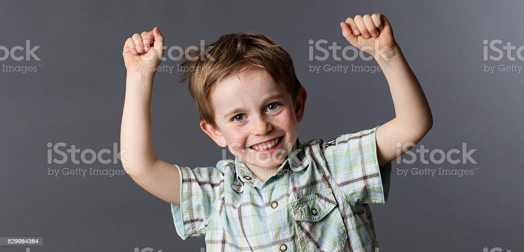 happy preschool child enjoying his winning success stock photo