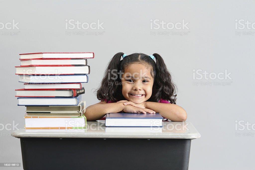 Happy Preschool Girl with Books stock photo