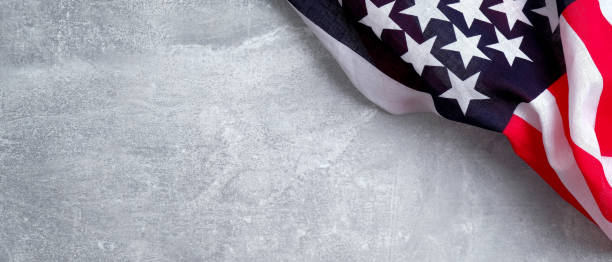 Happy Presidents Day banner design with American flag on stone background. USA Independence day, Veterans day, Labor day, or 4th of July celebration concept.