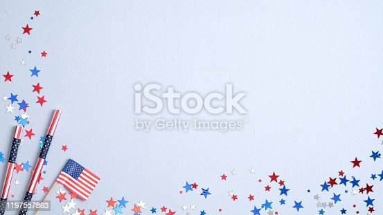508026042 istock photo Happy Presidents Day banner with American flag, drinking straws and confetti on blue background. USA Independence Day, American Labor day, Memorial Day, US election concept. 1197557863