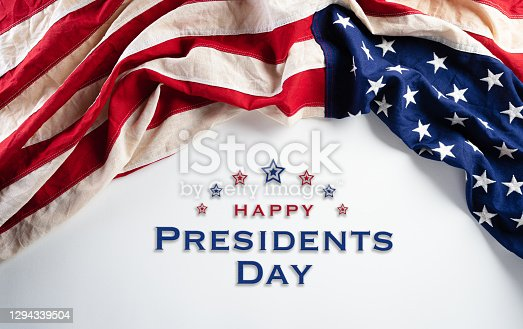 istock Happy presidents day concept with flag of the United States on white background. 1294339504