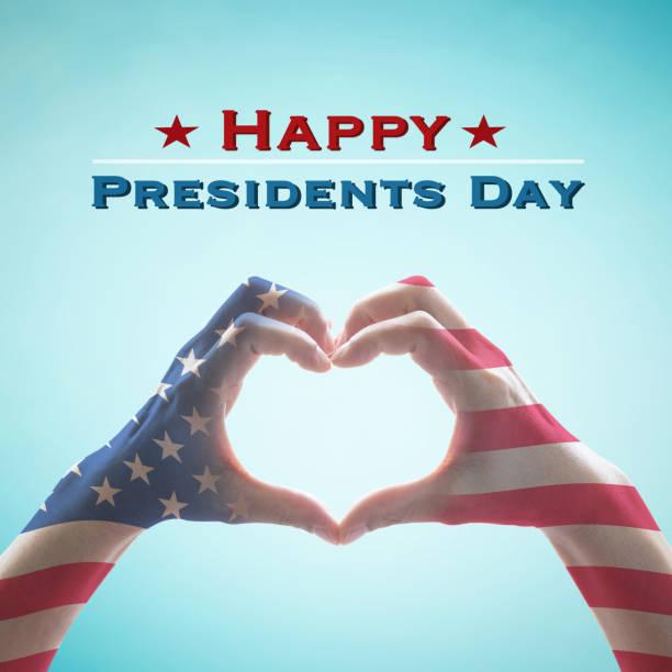 dia feliz presidentes com americano nos padrão de bandeira nas pessoas as mãos em forma de coração - presidents day - fotografias e filmes do acervo
