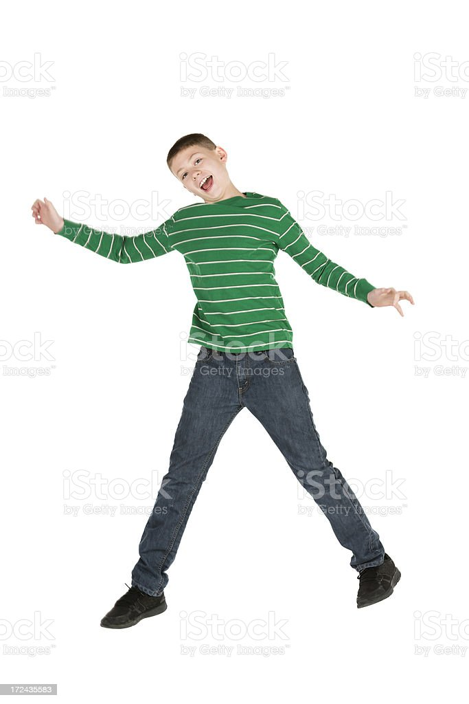 Happy pre-teen boy jumping on white royalty-free stock photo