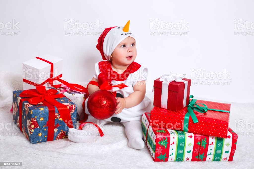 Happy Pretty Baby In Snowman Costume With Christmas Present Gift Boxes On White Background Stock Photo Download Image Now Istock
