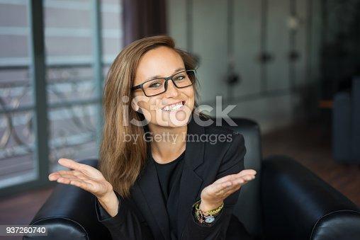 istock Happy Pretty Business Lady Proposing Idea in Lobby 937260740