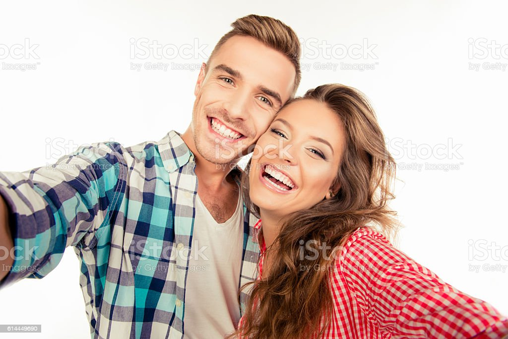 Happy pretty couple in love making selfie stock photo