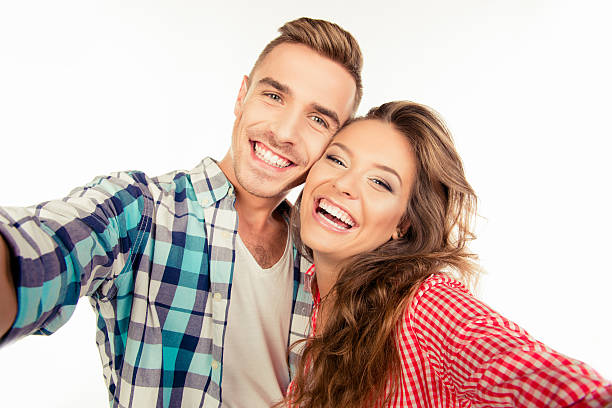 Happy pretty couple in love making selfie stock photo