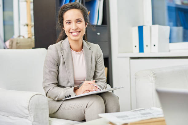 happy pretty psychologist in personal office - psychiatrist stock photos and pictures