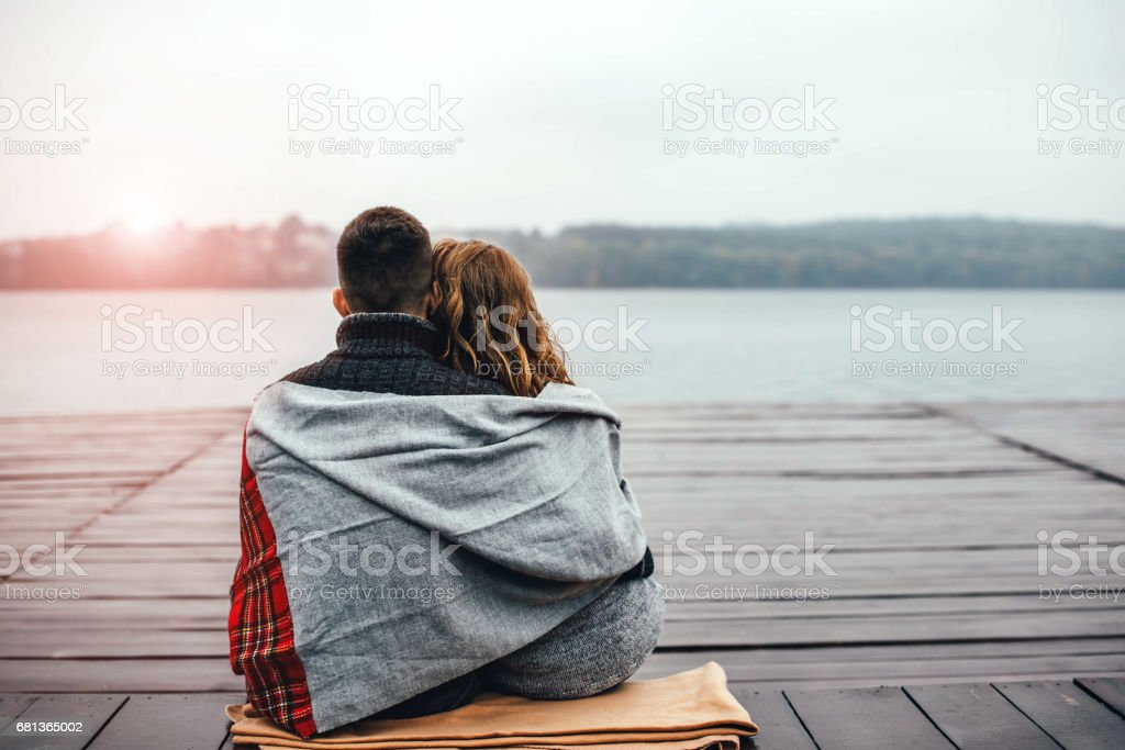 Happy pretty young couple outdoor stock photo