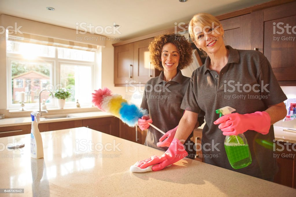 happy professional cleaning team stock photo