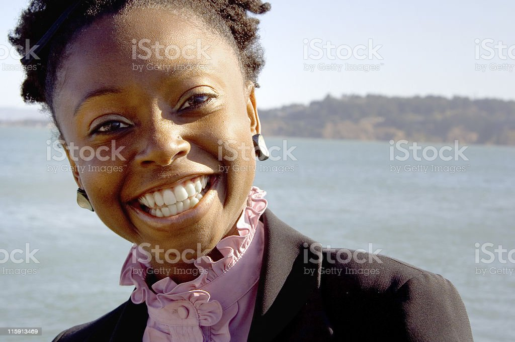Happy Professional Female on the Waterfront royalty-free stock photo