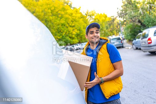 635967404 istock photo Happy professional shipping courier. 1140125393