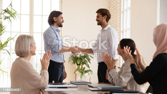 509032417 istock photo Happy proud manager handshake promote male worker, employee recognition concept 1182934051