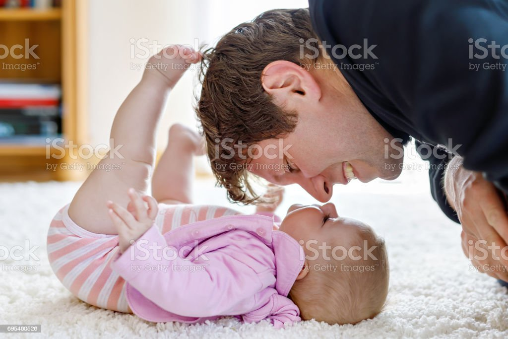 Happy proud young father with newborn baby daughter, family port stock photo