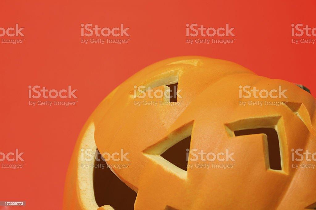 Happy pumpkin on orange background royalty-free stock photo