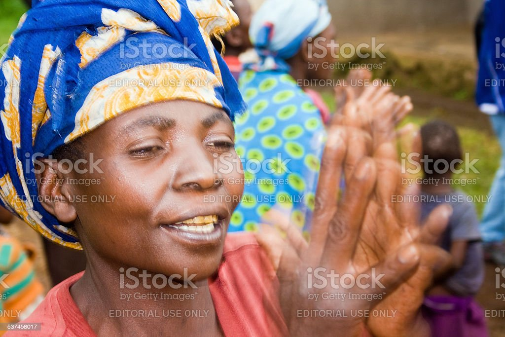 Happy pygmy woman claps her hands. stock photo