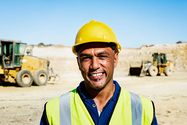Happy quarry worker at construction site stock photo