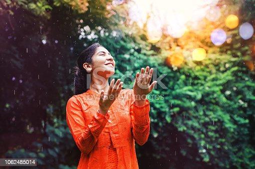 Beautiful indian woman under rain