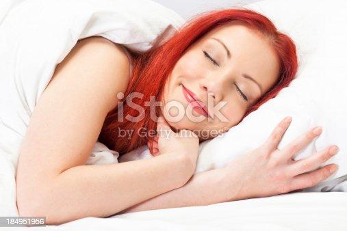 509031214istockphoto Happy readhead young woman sleeping 184951956