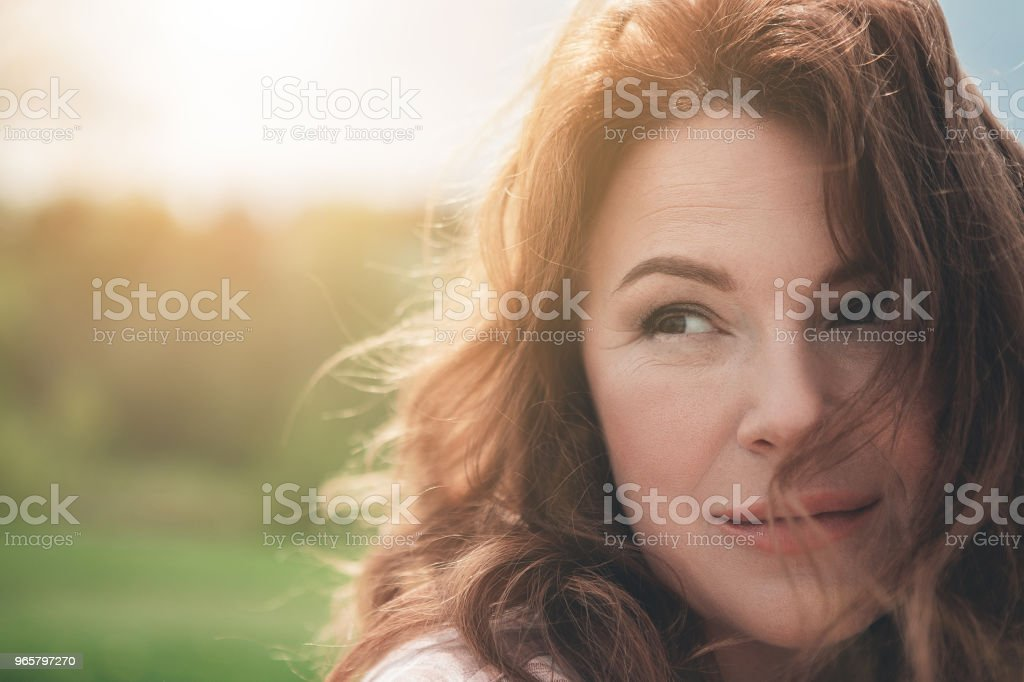 Happy red-haired lady enjoying every moment in nature stock photo