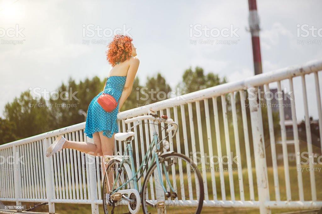 Happy redhead on the bridge stock photo