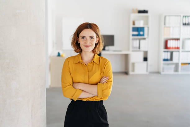 Happy relaxed confident young businesswoman stock photo