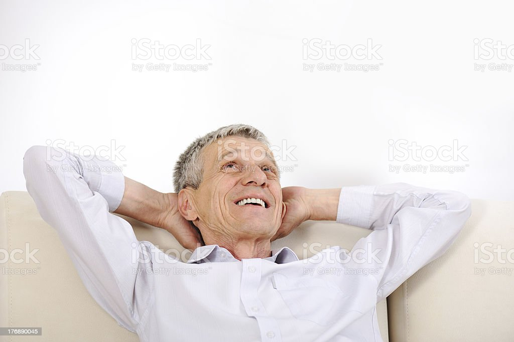 Happy relaxed elderly man at home royalty-free stock photo