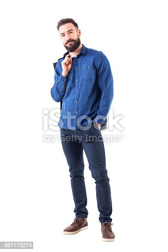931173966istockphoto Happy relaxed smiling man in blue denim shirt carrying jacket over shoulder looking at camera 931173274
