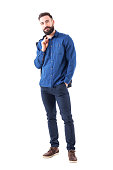 istock Happy relaxed smiling man in blue denim shirt carrying jacket over shoulder looking at camera 931173274