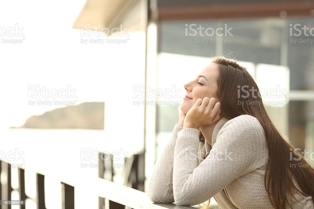 Happy relaxed woman in a beach hotel stock photo
