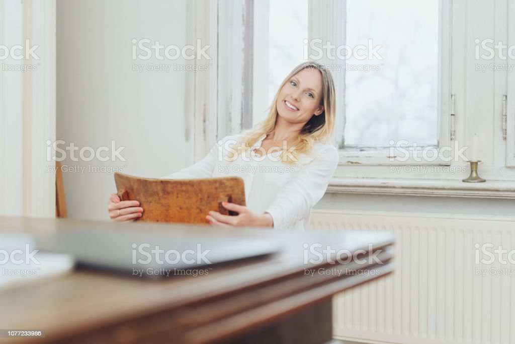 Happy relaxed woman swinging on a chair