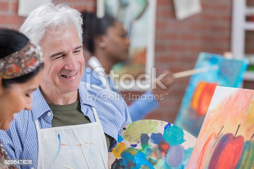 658645980 istock photo Happy retired Caucasian man takes art class 659542626