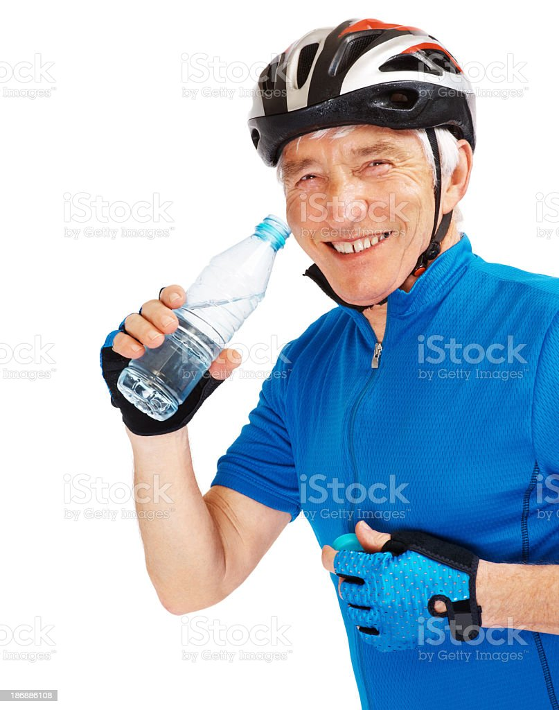 Happy retired cyclist drinking water against white royalty-free stock photo