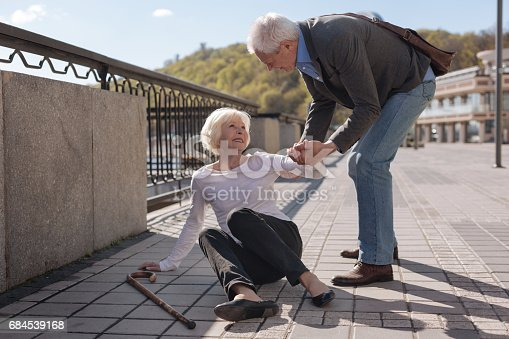 istock Happy retired family solving their problems in the street 684539168