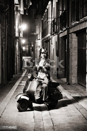 Happy retro biker, in the street at night. ( monochrome version )
