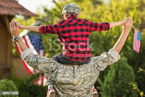 istock Happy reunion of soldier with family 866913638