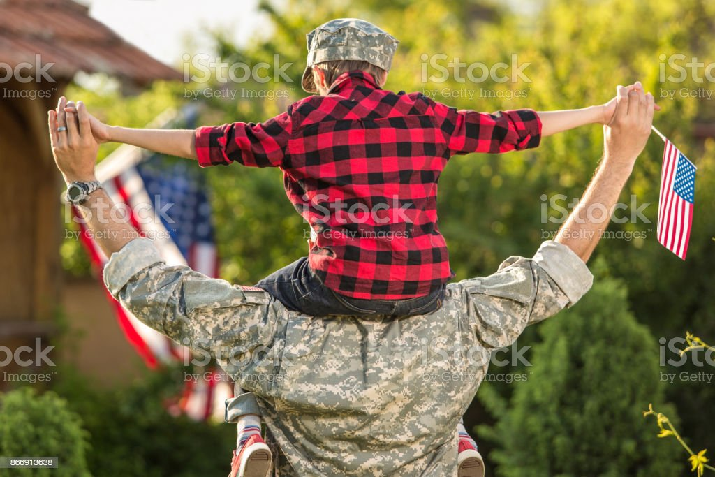 Happy reunion of soldier with family stock photo