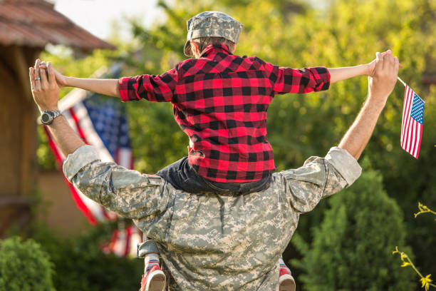 happy reunion of soldier with family - armed forces stock photos and pictures