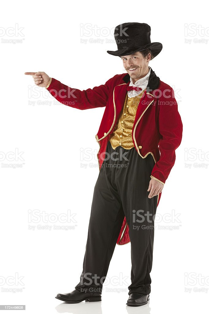 Happy ring master pointing stock photo