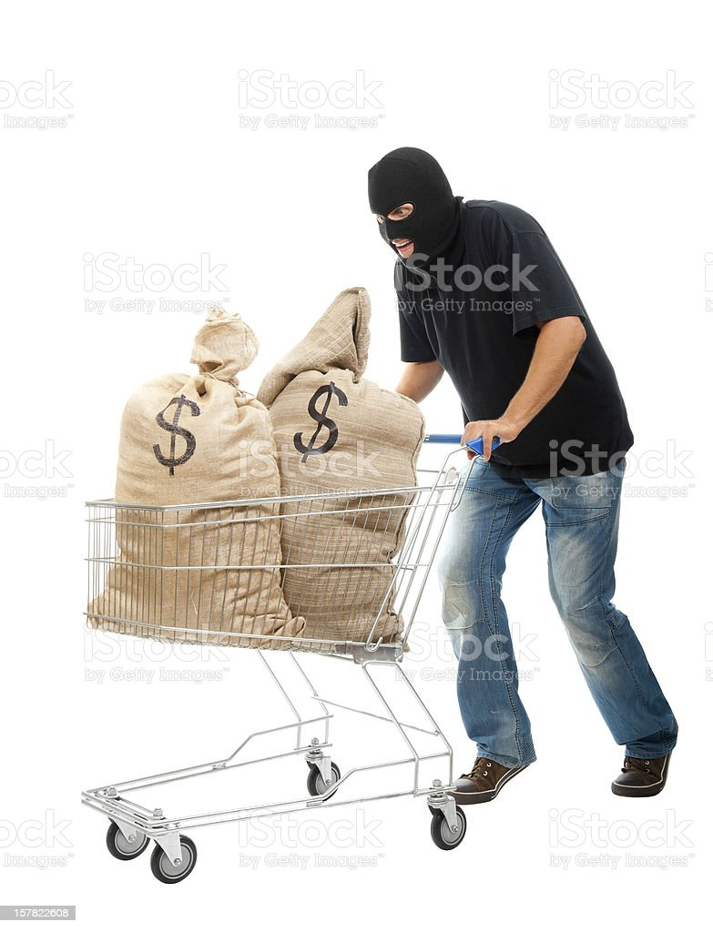Happy robber with sack full of dollars stock photo