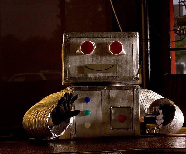 happy roboter in der bar - bier kostüm stock-fotos und bilder