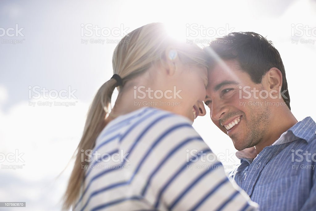 Happy romantic couple embracing in field royalty-free stock photo