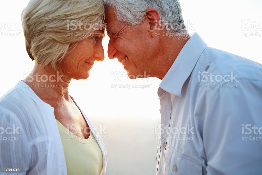 Happy romantic senior couple looking at each other royalty-free stock photo