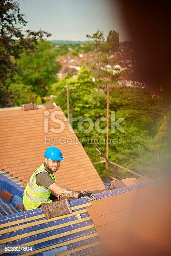 istock happy roofer 823327804