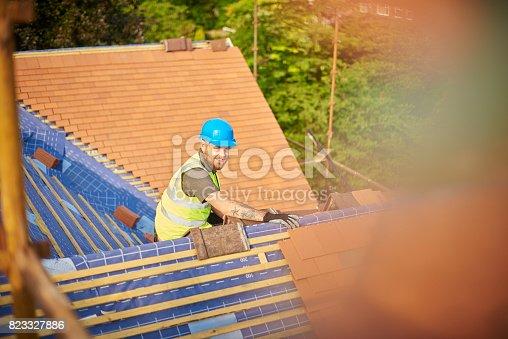istock happy roofer 823327886