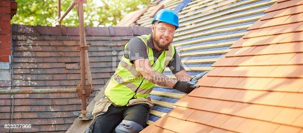 istock happy roofer portrait 823327966