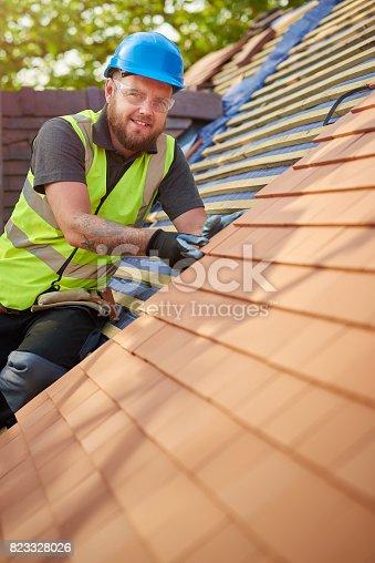 istock happy roofer portrait 823328026