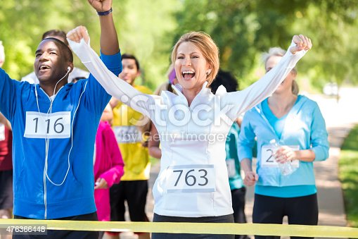 istock Happy runners celebrating as they win marathon or 5k race 476366448