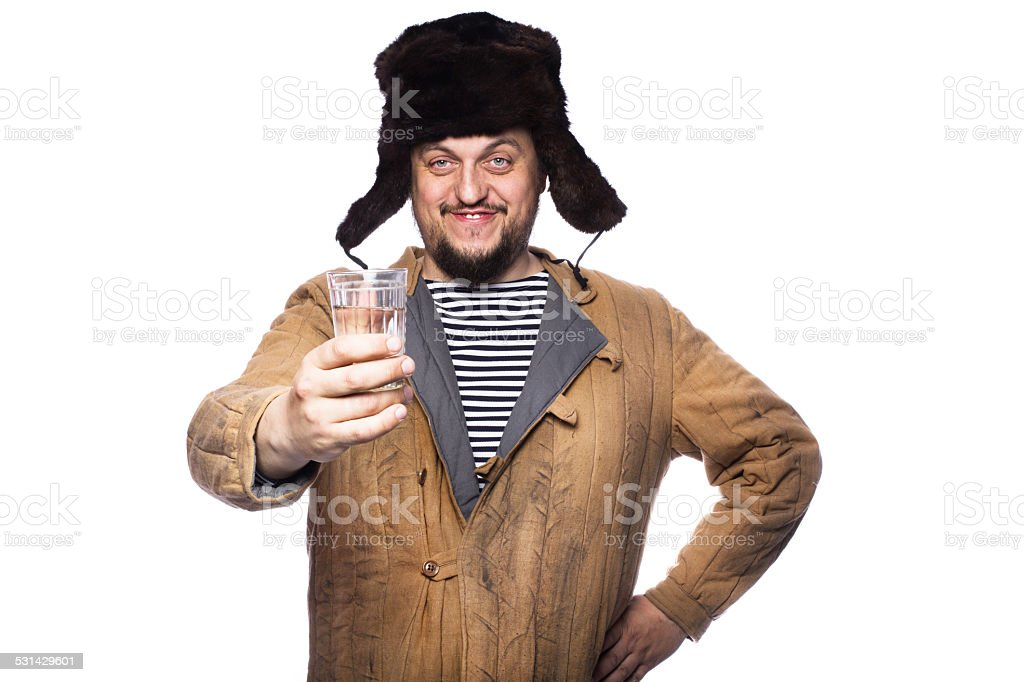 Happy russian man offering a vodka, cheers stock photo